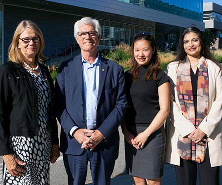 From left: Deborah Buszard, Minister Carr, Yu Teshima (fourth-year management student) and Ananya Mukherjee Reed.