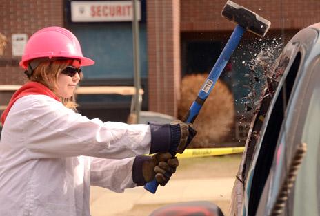 Natasha Orlitzky had a smashing good time during Engineering Week at UBC's Okanagan campus Wednesday, taking a sledgehammer to a van for charity.