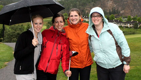 Despite a slight drizzle, Team Four were all smiles at the 6th Annual UBC Hack and Whack Golf Tournament at the Gallagher's Canyon Golf & Country Club. Team members included, left to right, Breanne Molnar, Kaliopi Kollias, Jamie Frezell and Jessica Davidson.