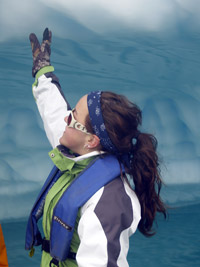 Jenna Gall, a third-year environmental science student at UBC's Okanagan campus, touches an iceberg for the first time during a trip to Antarctica.
