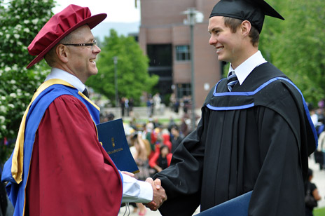 Father and son, Paul and Brian Stephenson, congratulate one another upon graduation