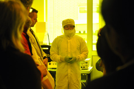 An engineering student tours guests through the class 100 clean room in the new Micro Electro Mechanical (MEMS) Fabrication facilities.