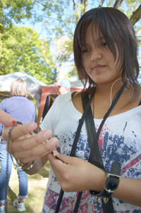 First year student Charlene Rabesca, from NWT, looks at locally produced art during a tour to the Okanagan Nation Salmon Feast.