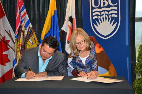 Westbank First Nation Chief Robert Louie and Deborah Buszard, Deputy Vice-Chancellor and Principal of UBC's Okanagan campus, sign a memorandum of understanding between the Okanagan Nation Alliance and UBC on Friday morning.