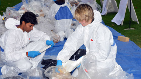 Omkrishna Shah, 2nd year management student, and Amanda Enevoldson, 2nd year biochemistry student help sort through trash at this year's waste audit.