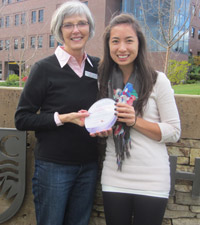 Barb Hoy, Kelowna Run for the Cure Co-Director, presents nursing student Robyn Kosugi with the Post-Secondary Challenge Team Captain Leadership Award