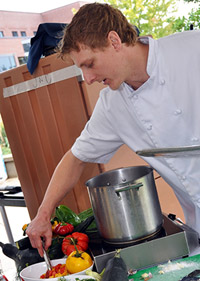 ARAMARK Chef Mathew Morazain demonstration cooking with fresh local produce during UBC's Okanagan campus Community Day. Morazain was among the top three Canadian chefs competing at the ARAMARK Culinary Excellence National Challenge in Florida Nov. 13.