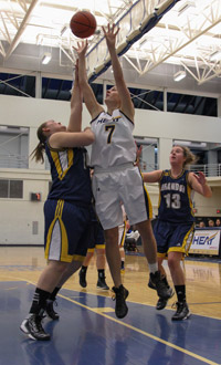 Fifth-year Roslyn Huber is now the school's leader in career points and rebounds. (Photo by Dale Abbey)