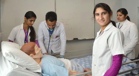Visitors from the Royal Institute of Nursing Kamalpreet Kaur, Parminder Singh, Sukhmanpreet Kaur, and their teacher Rajwant Bajwa, in one of the human patient simulator labs at the School of Nursing.
