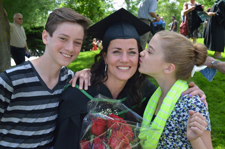 Wendi Wright is hugged by her children Diego and Diante after graduating with a Bachelor of Science degree in Human Kinetics at UBC's Convocation on Friday.