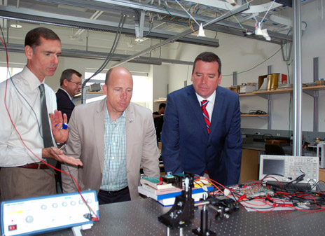 UBC Assoc. Prof. Richard Klukas explains his research on indoor LED positioning to federal Minister of Industry Christian Paradis and Kelowna-Lake Country MP Ron Cannan during a visit to UBC's Okanagan campus on June 28.