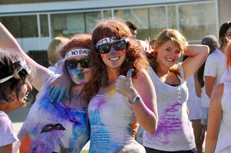 """Participants such as Jess O'Toole and Kate Helmore (foreground, left to right) are turned into human canvases during Colour Me UBC. Part of Create on Sept. 3, the event outfits students with Tuum Est (""""It is up to you"""") T-shirts and a colour mixture made from cornstarch and tempera paint powder."""