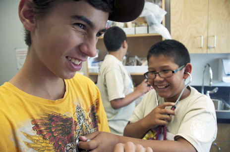 Okanagan high school students Ryan Price, left, and Brenden Wright try out their stethoscope skills during the nursing workshop at the Indigenous Summer Scholars Camp.