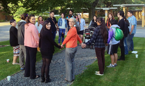 UBC students Carla Miles (pink sweater) and Crystal Prince are joined by Assist. Prof. of Indigenous Studies Margo Tamez (orange sweater) and other UBC students in a prayer circle Wednesday morning prior to attending the Truth and Reconciliation Commission's national event in Vancouver.