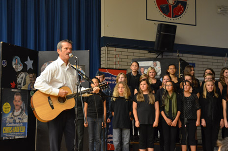 Col. Chris Hadfield plays the song, Is Somebody Singing, with students at École KLO Middle School.