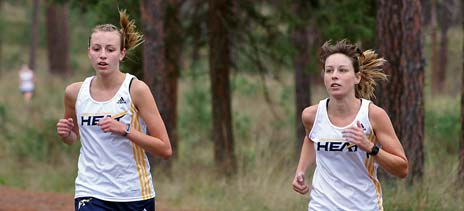 Julianna Neudorf on left and Trisha Metro on right show that pack style running that is quickly becoming a strength of this Heat team. (Photo Heat athletics)