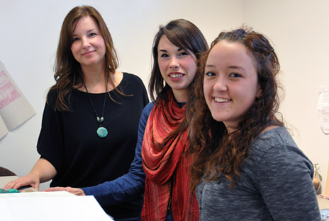 UBC's Michelle Lowton, (left), chats with students Kelsie Balehowsky and Jenna Gall. Both students have organized community events with assistance from UBC's Tuum Est Student Initiative Fund.