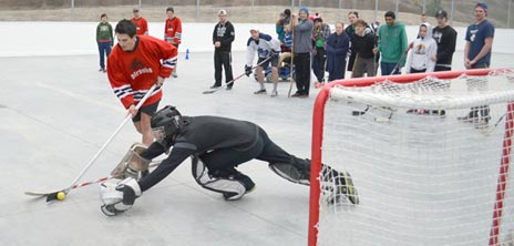 Aboriginal Programs & Services' player Clayton Schroeder is stopped in his shoot-out attempt.