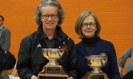 Thompson Rivers University President and Vice-Chancellor Alan Shaver (left), holding the Men's Presidents' Cup. On the right with the Women's Cup is Deputy Vice-Chancellor and Principal Deborah Buszard.