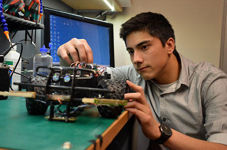 Alex Wiecke, a second-year electrical engineering student at UBCO, makes final adjustments to his customized radio-controlled truck prior to the UBCO Mechatronics Club Auto Rally finals. Wiecke placed second in the five-team event.