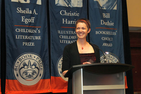 Ashley Little at the podium accepting BC Book Prizes for her novels Anatomy of a Girl Gang and The New Normal.