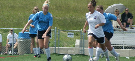New Heat fullback, Jennifer Yamaoka (right, in white) in action on the Nonis Sports Field - her new home for varsity soccer. (photo contributed)
