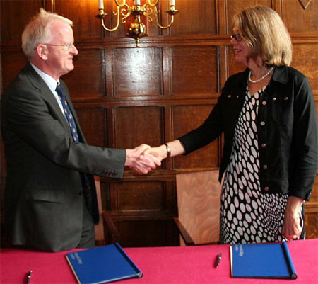 Imperial College London Provost James Stirling congratulates UBC Deputy Vice-Chancellor and Principal Deborah Buszard following signing of a collaboration agreement between the institutions.