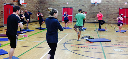 Students doing yoga with local athletes going to the Special Olympics Canada Summer Games in Vancouver this July.