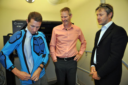 From left: PhD student Colin Wallace tries on a dirt biking shirt equipped with Armourgel protective covering, while UBC's Paul van Donkelaar and Imperial College's Dan Plant look on. Van Donkelaar, director of UBC's School of Health and Exercise Sciences, studies concussions and is interested in Armourgel's unique properties for use in sports helmets.