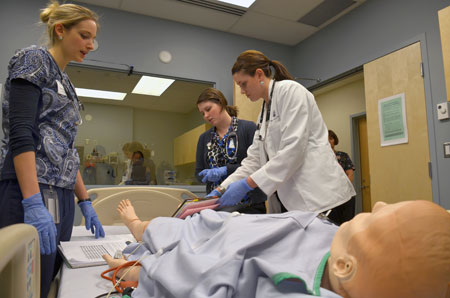 School of Nursing graduate Christine Gregory and Southern Medical Program students Alison Leighton and Robyn Buna work to solve a patient emergency in the Pritchard Simulation Centre at Kelowna General Hospital, part of the clinical studies program for nursing and medical students.