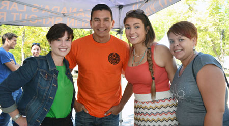Students Kelly Panchyshyn, left to right, Elora Bascello and Mary Song jumped at the chance to be photographed with the charismatic Wab Kinew at the Okanagan Nation Alliance Salmon Feast in Okanagan Falls.