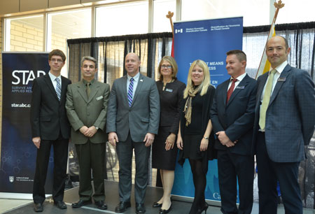 At the announcement Tuesday morning, from left, UBC undergraduate student researcher Ephraim Nowak; Assoc. Prof. Homayoun Najjaran; Kelowna-Lake Country MP Ron Cannan; UBC Deputy Vice-Chancellor Deborah Buszard; Michelle Rempel, Minister of State for Western Economic Development; Phil Lancaster, Founder and President of Helios Global Technologies; and UBC Okanagan Vice-Principal Research Prof. Gord Binsted.