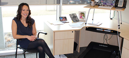 Mary Jung, assistant professor with the Faculty of Health and Social Development, has a treadmill at her desk to ensure she can incorporate exercise into her daily routine.