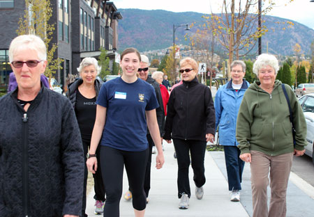 UBC Southern Medical Program student Celine Akyurekli (centre) leads a walk around the block with Walk n' Talk for Your Life participants in West Kelowna.