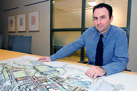 Anthony Haddad, director of Okanagan Campus Planning and Development, with a concept drawing from the draft UBC Okanagan Master Plan.