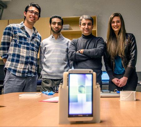 With the smartphone lab prototype, from left, Engineering Instructor Ali Ahmadi, PhD Candidate Mohamed Yafia Salem, Assoc. Prof. Homayoun Najjaran, and mechanical engineering student Jessica Van Brummelen.
