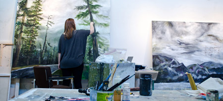 Fourth-year BFA grad student Melissa Demale finishing up paintings for the show.