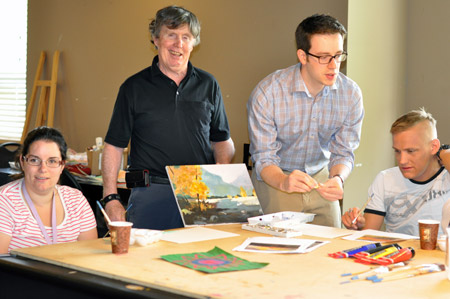 Medical student Maksim Parfyonov, second from right, leads the weekly art class with Connect residents Amadee Hollowink, Glen O'Connor, and Matthew McKay.