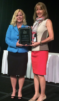 WRAP Coordinator Tracey Hawthorn is presented with the first-prize in CAUBO's annual Quality and Productivity awards.