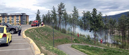 The Kelowna Fire Department was on campus to deal with a small grassfire above H lot on April 30. (Photo credit: Dan Odenbach)