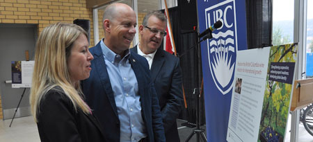 Discussing Friday's Western Economic Diversification Canada funding announcement, from left, Minister of State Michelle Rempel, Kelowna-Lake Country MP Ron Cannan, and Prof. Roger Sugden, Dean of the Faculty of Management.