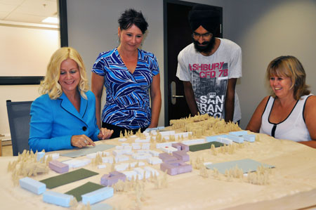 Members of the cake committee examine the model created for the campus master plan consultations last winter. The committee (from left): WRAP Coordinator Tracey Hawthorn, HR Advisor Tena McKenzie, engineering student Jannat Bachhal and WRAP Assistant Deb Oakley hopes to build a cake resembling the current campus.