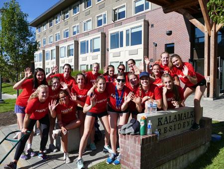 """Members of the UBC Okanagan Heat women's volleyball team were among dozens of Heat student-athletes on hand Sunday to help 1,200 fellow students move in to residences on campus during the annual """"move-in"""" day."""