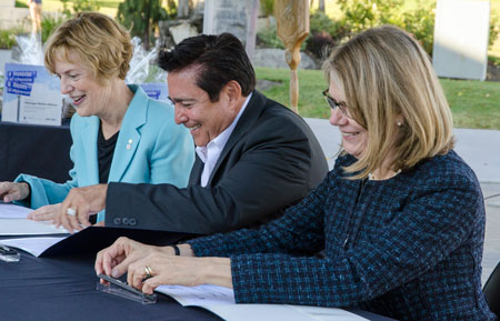Signing the renewed memorandum of understanding on Monday afternoon were, from left, UBC Interim President Martha Piper, Westbank First Nation Chief Robert Louie, and UBC Deputy Vice-Chancellor and Okanagan Principal Deborah Buszard.