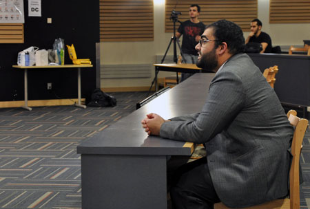 """Adnan Bhat listens while Shaykh Navaid Aziz, a chaplain and youth counsellor from Calgary, answers questions during the """"Misconceptions about Islam"""" event held at in the Arts and Sciences Centre on November 2."""