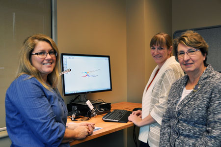Earllene Roberts, with the Disability Resource Centre, and Barbara Sobol, undergraduate services librarian, demonstrate some of the equipment available at the campus's new Inclusive Technology Lab to Provost and Vice-Principal Academic Cynthia Mathieson (right).