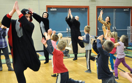 ETEP teacher candidates, Maddie Horvat, Natalie Rivard, Hayden McIntosh and Kelsey McLellan show off their dance moves to Quigley students.