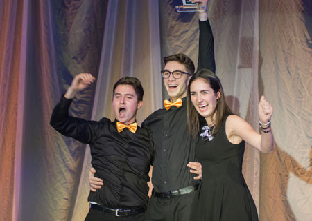 Third-year Faculty of Management students (from left) Nick Ross, Graeme Sailor, and Jennifer Stolarchuk celebrate their first-place finish at JDC West for entrepreneurship. Photo courtesy JDC West 2016.
