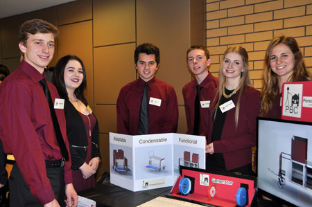 First-year engineering students Ryan Kozak, Erin Kearney, Tyler Ho, George Muson, Emily Simmends, and Kaley Wainwright display their 'personal belongings cart' design during the recent Applied Science Design Showcase.