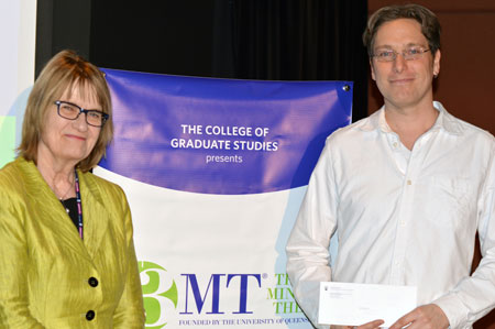 Miriam Grant, left, congratulates 3MT winner Mike Unrau.